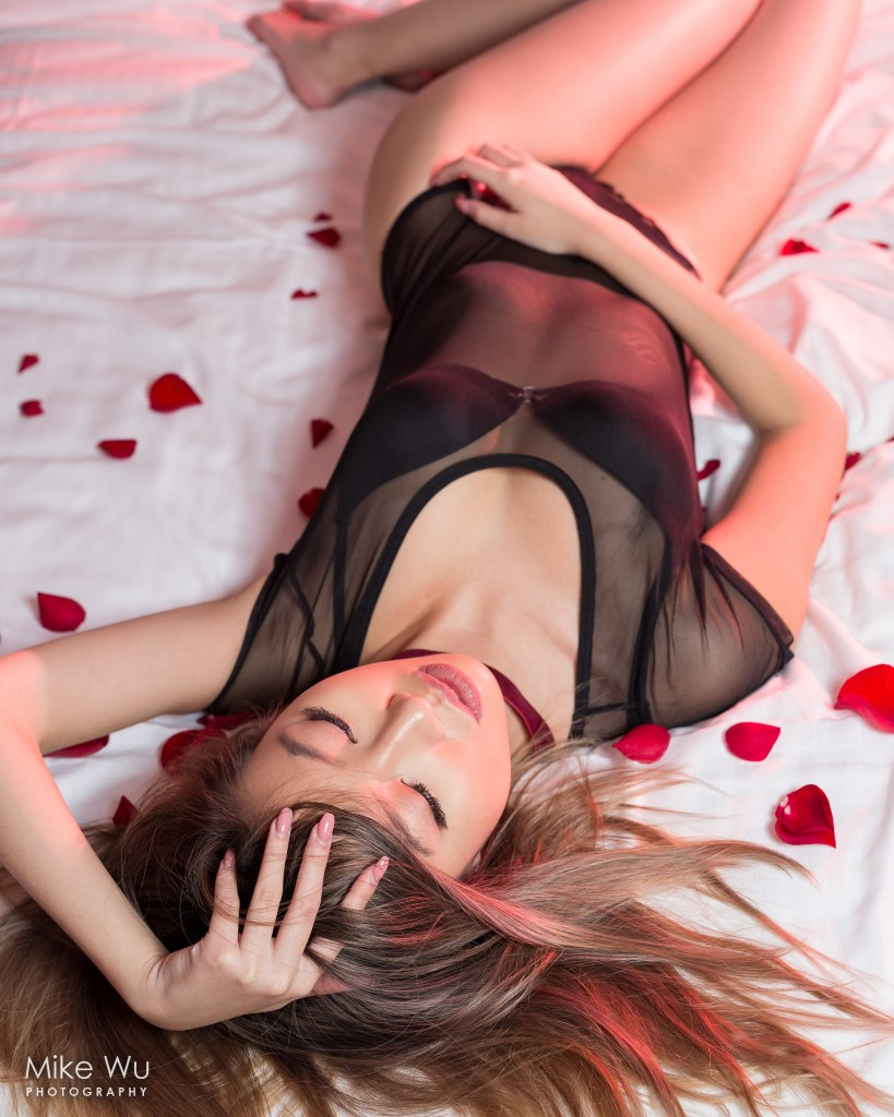 vancouver portrait photographer mike wu indoor studio photoshoot bed asian chinese lingerie boudoir sexy red gel unique hair published rose petals lying down sleep valentine's day seductive