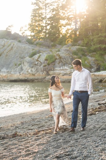 Vancouver, wedding, engagement, photos, whytecliff park, natural, beach, sunset, flare, trees, water, waves, sand, rocks, nature, holding hands, love, couple, loving, beautiful, environment, photography, dress, style, stylish