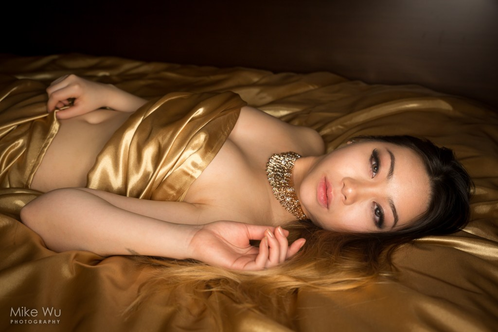 vancouver portrait photographer mike wu, gold, jewelry, necklace, satin, sheets, bed, lying, asian, blond, beautiful, female, girl, boudoir, sensual, golden, shiny, chinese, unique theme, shiny, lovely