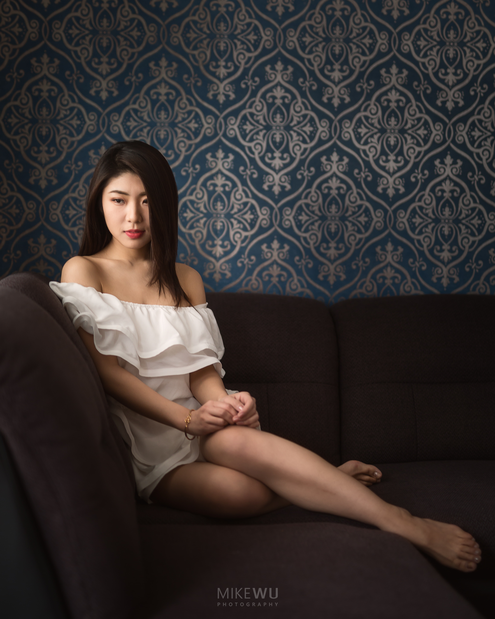vancouver portrait photographer mike wu indoor studio photography natural wallpaper inside couch comfy cozy white dress legs chinese beauty toronto