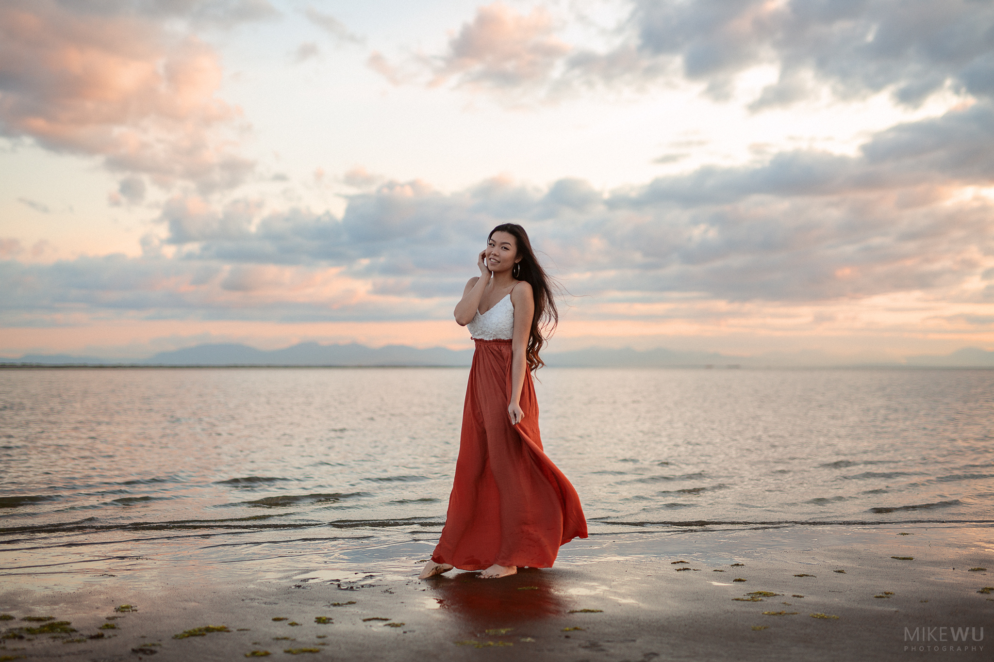 vancouver portrait photographer mike wu beach dress wind hair asian beauty beautiful sky waves water clouds sunset pink