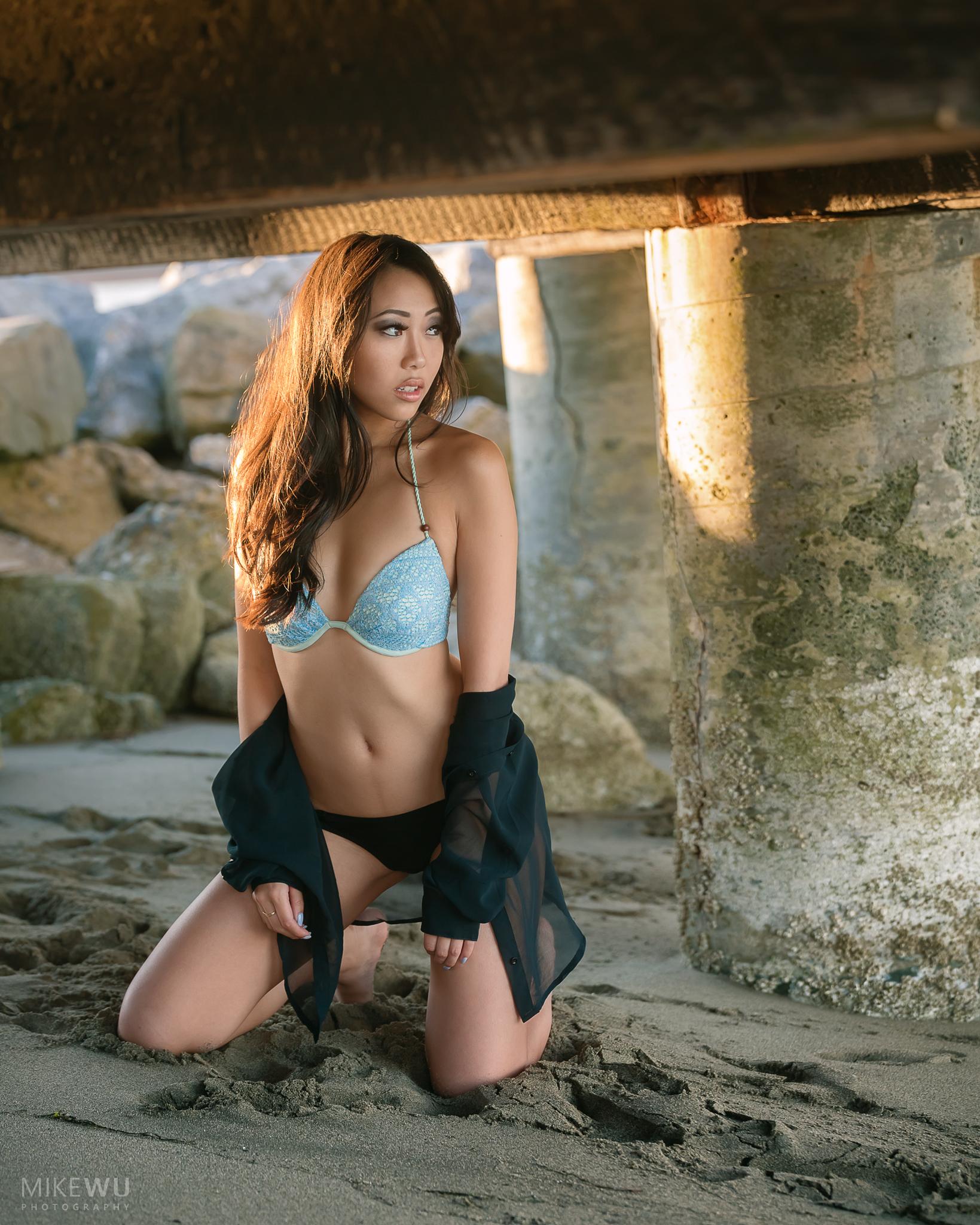 vancouver portrait photographer mike wu beach dock sunset golden hour natural light sand pier bikini female model swimsuit swimwear asian beauty beautiful blue gaze jericho kitslano spanish banks english bay