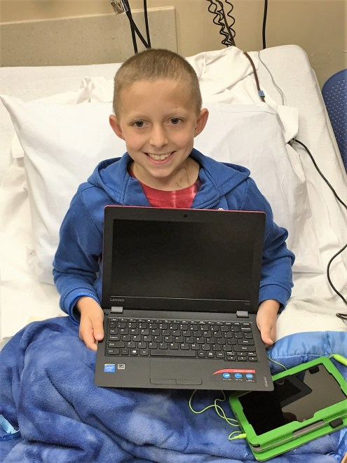 patient with a laptop, helping kids cope with cancer