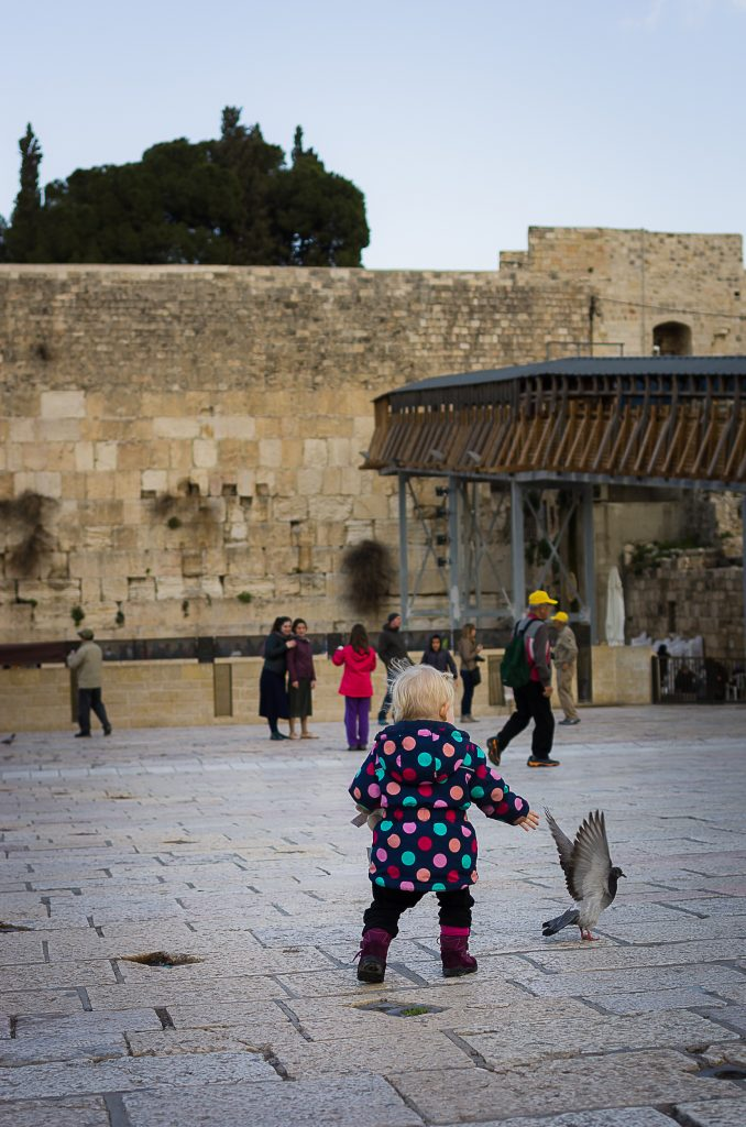 Lién chasing birds at the Western wall