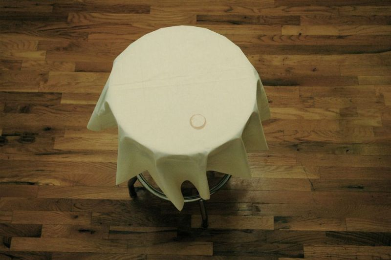 "Marek Milde ""The Same and Not the Same"" (face) 2009, coffee table, tablecloth, coffee, diameter 37 inches"