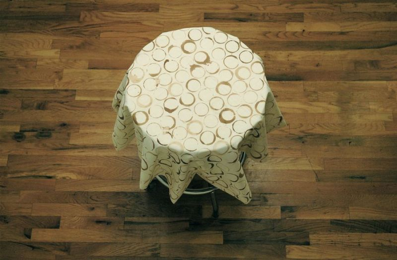 "Marek Milde ""The Same and Not the Same"" 2009, coffee table, tablecloth, coffee, diameter 37 inches"