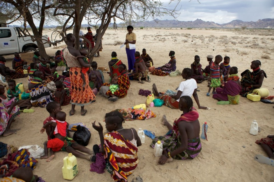 pregant mothers meet under a tree in Turkana, Kenya