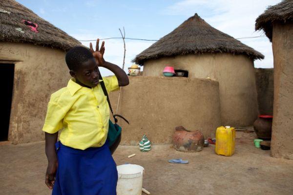 School girl leaving home Ghana