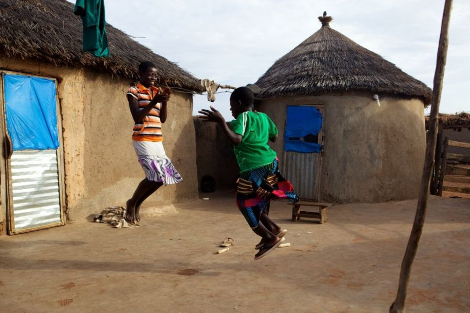 Girls playing jumping game in their home compound in northern Ghana, Africa