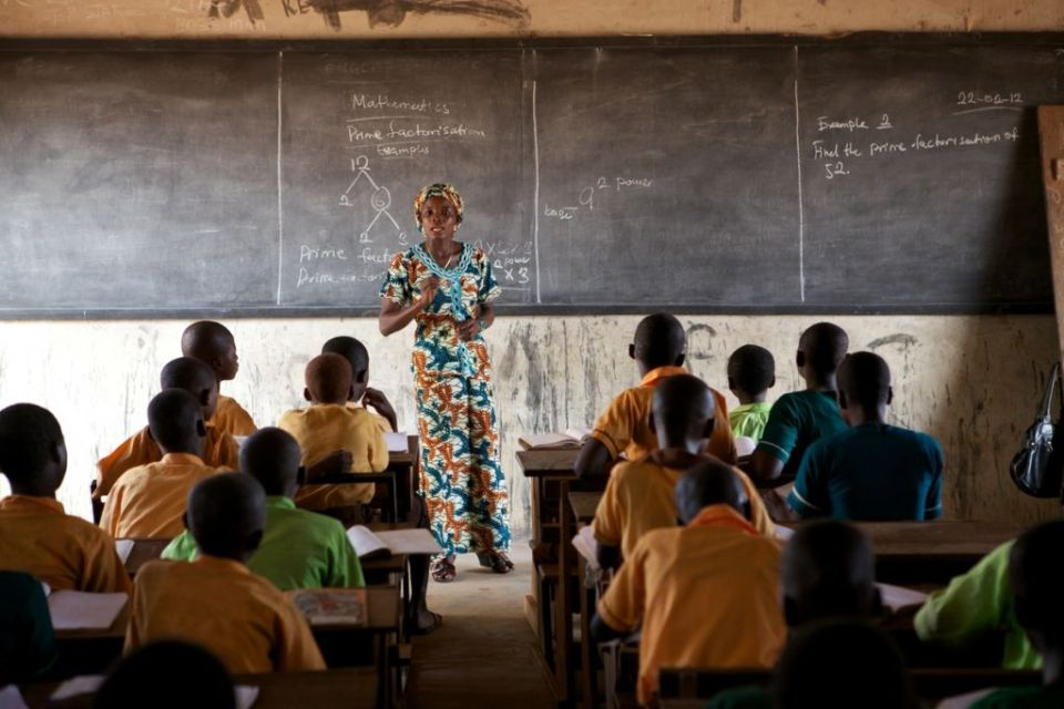 Teacher at the front of a classroom in Ghana, Africa