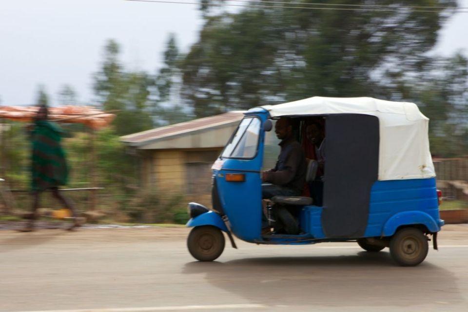 An Ethiopian Bajaj driving on the road