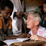 A VSO volunteer teaching a pupil in Ethiopia.