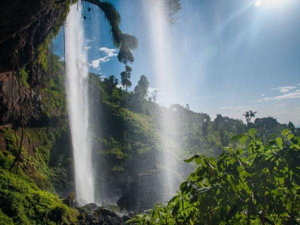 Sun pouring through a waterfall in Uganda