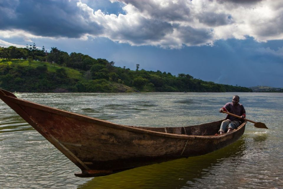 A man paddling a boat on the River Nile in Jinga, Uganda