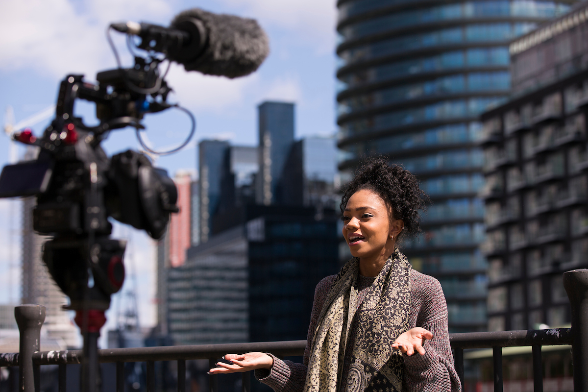 A young woman taking to camera during an interview, London.