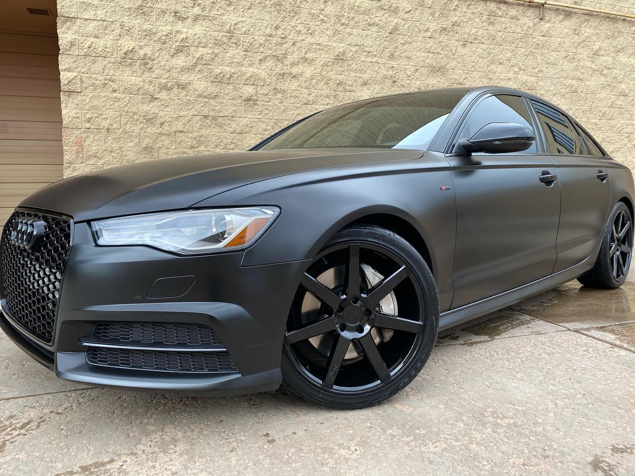 Audi A6 blacked out! Satin black vinyl wrap, gloss black chrome delete, tinted taillights and new custom wheels!