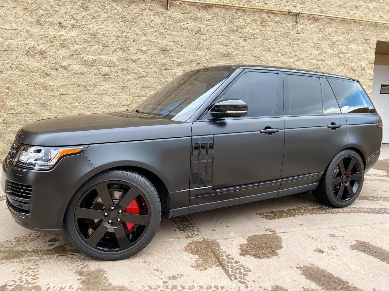 Range Rover blacked out. Satin black vinyl wrap, gloss black trim, powder coated wheels. Back view