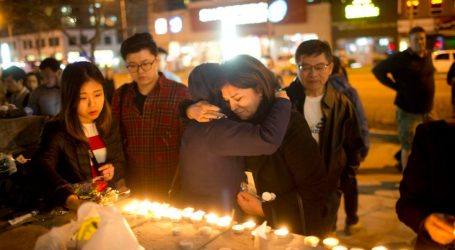 Grieving city residents gather at makeshift memorial on Yonge St.