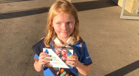 Edmonton girl guide sells out of cookies in front of pot shop on first day