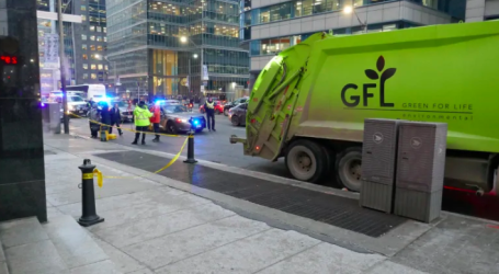 1 person dead after being struck by garbage truck in downtown laneway