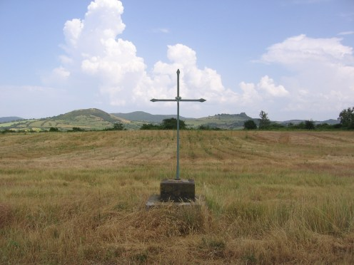 A cross marker in a field in France.