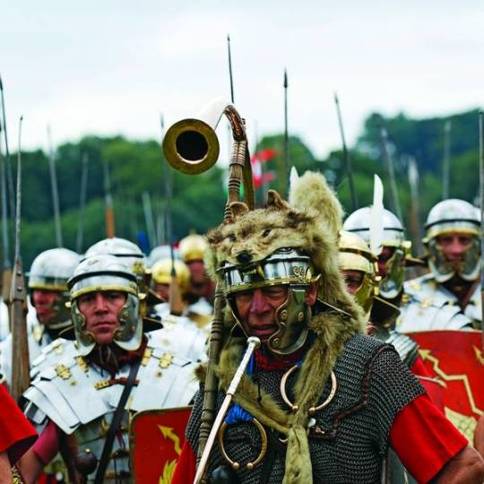 Full Roman Century on the march with infantrymen. horn-blower, standard bearer, centuruion (sergeant major) and equipment. Image shot 2010. Exact date unknown.