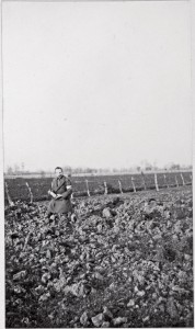 Fred Davidson cradles a spent shell behind the lines at La Boutillerie, south of Armentieres.