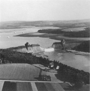 Photograph of the breached Möhne Dam taken by Flying Officer Jerry Fray of No. 542 Squadron from his Spitfire PR IX.