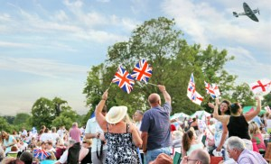 Battle Proms crowd with flags and Spitfire FI