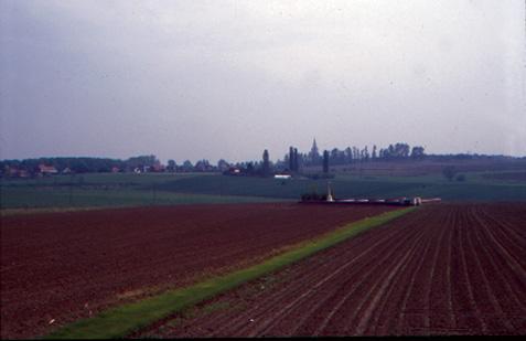 Wijtschate church spire rises above the Messines Ridge beyond Spanbroekmolen CWGC cemetery.