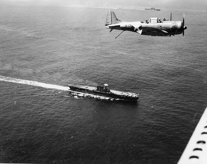 Douglas Dauntless flying over USS Enterprise