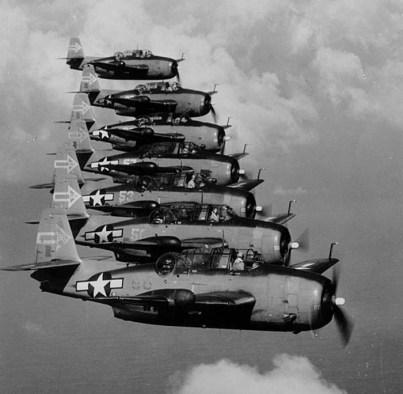 A squadron of Grumann Avenger torpedo-bombers in flight.