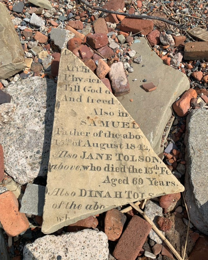 Remains of a gravestone lying on Liverpool's Crosby Beach –  just one of the countless artefacts uncovered by the student.