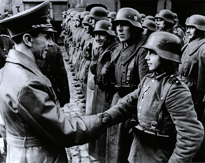 Goebbels inspects some of the last defenders of the Third Reich.