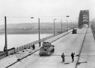 British Shermans cross the bridge at Nijmegen.