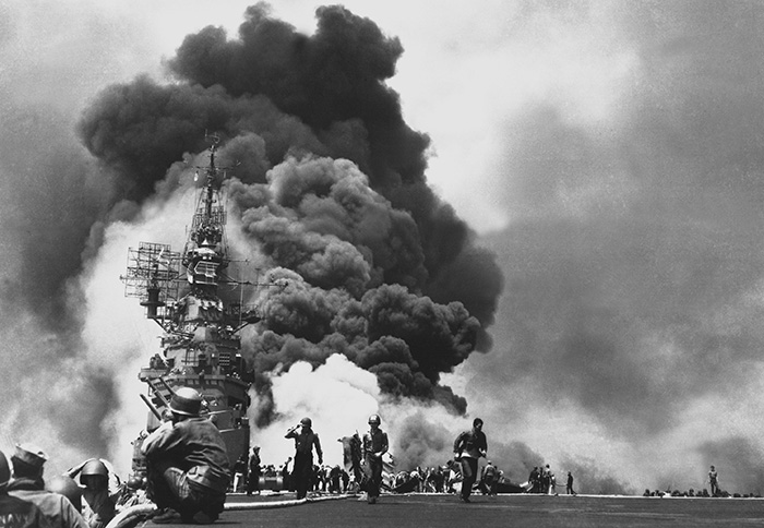 The USS Bunker Hill burns after two kamikaze strikes in 30 seconds.
