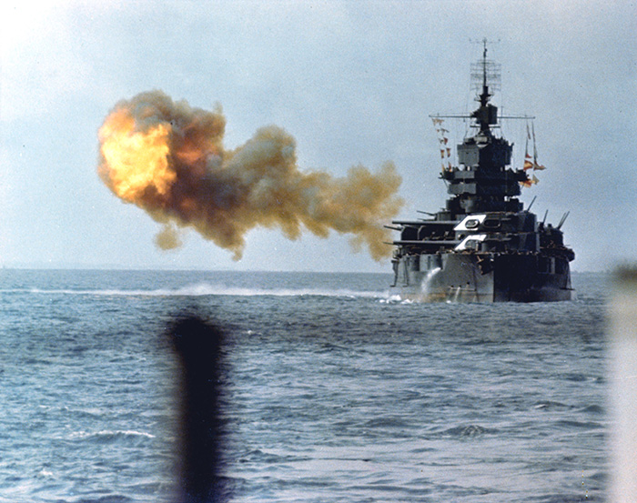 The USS Idaho shells Japanese positions on Okinawa. The US fleet played a key role in providing heavy artillery support to US ground forces.