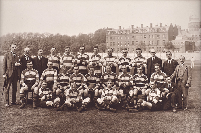A team photograph of the 1920-21 Cardiff RFC squad. Lewis is seated in the middle row, holding the ball.
