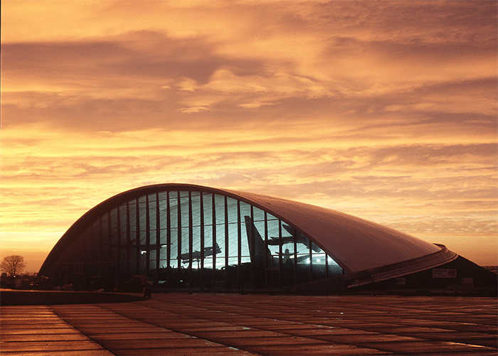 The American Air Museum at Duxford. Designed by Norman Foster, it received critical acclaim for its modern take on traditional aircraft hangars. Image: Historic England.