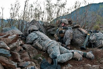 NURISTAN PROVINCE, Afghanistan – Just minutes before an eight-hour firefight, U.S. Army Spc. Nathan Allen (right), an infantry team leader from Atlantic, Iowa, and U.S. Army Pvt. Cody M. Meidinger (left), a squad automatic weapon machine gunner from Emporia, Kan., both assigned to Company C, 2nd Battalion, 327th Infantry Regiment, Task Force No Slack, scan the horizon from their fighting position on a remote hilltop in the Shal Valley in eastern Afghanistan's Nuristan Province, Nov. 7. (Photo by U.S. Army Staff Sgt. Mark Burrell, 210th Mobile Public Affairs Detachment)