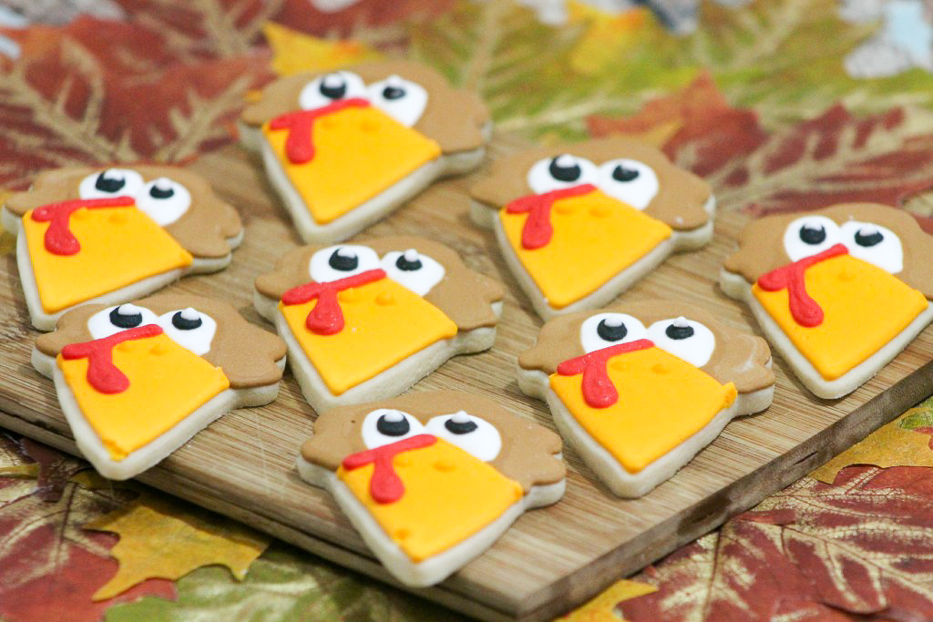 Adorable Turkey Sugar Cookies! Are you finalizing some of your Thanksgiving recipes but need that special something? I've got a cute turkey sugar cookie recipe that will wow your guests! Wait until you see what cookie cutter was used! These cookies are not only adorable, but they are also crispy and delicious! Recipe for Thanksgiving day cookies. #Thanksgiving