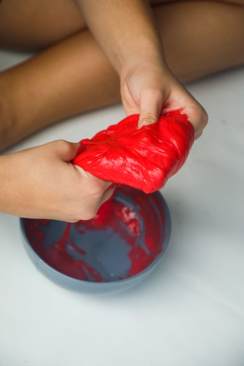 How to Make Easy Slime Recipe- Oozing Blood Slime for Halloween. The best Halloween slime recipe using no Borax! Perfect for Halloween crafts & Parties. Learn how to make this gross looking slime by reading our post, it includes step by step instructions & a video!