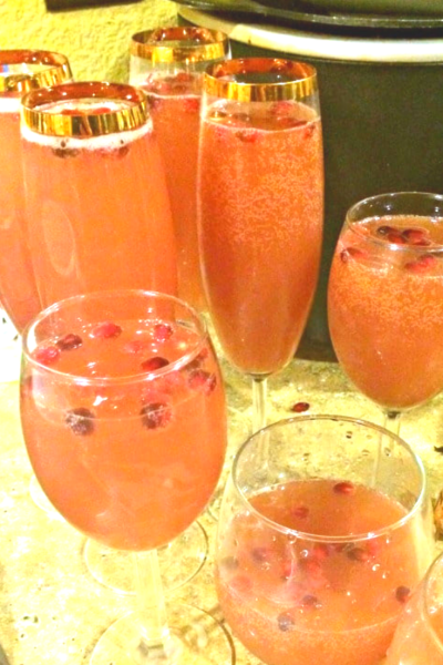 Pomegranate Orange Cranberry Sparkling Cocktail or Mocktail Holiday Punch The Ultimate List of Holiday Cocktail & Mocktail Recipes. With over 50 recipes to choose from and constantly adding more, you will never be short of ideas! If you are hosting a Holiday Party or are enjoying a night in with a Hallmark movie, you are sure to find the right drink for the occasion in this post. Cheers!