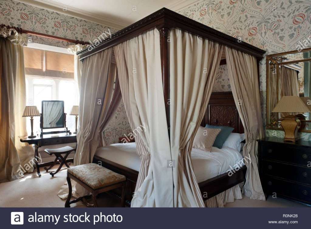 four poster bed with curtains high resolution stock