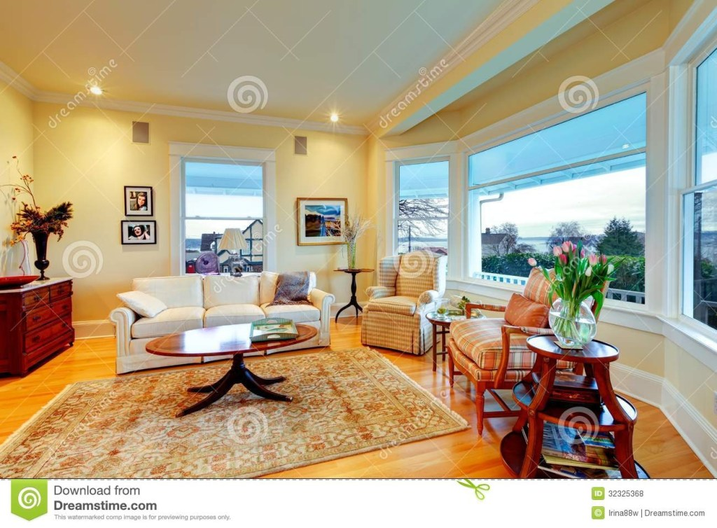 golden bright yellow luxury living room with fireplace and