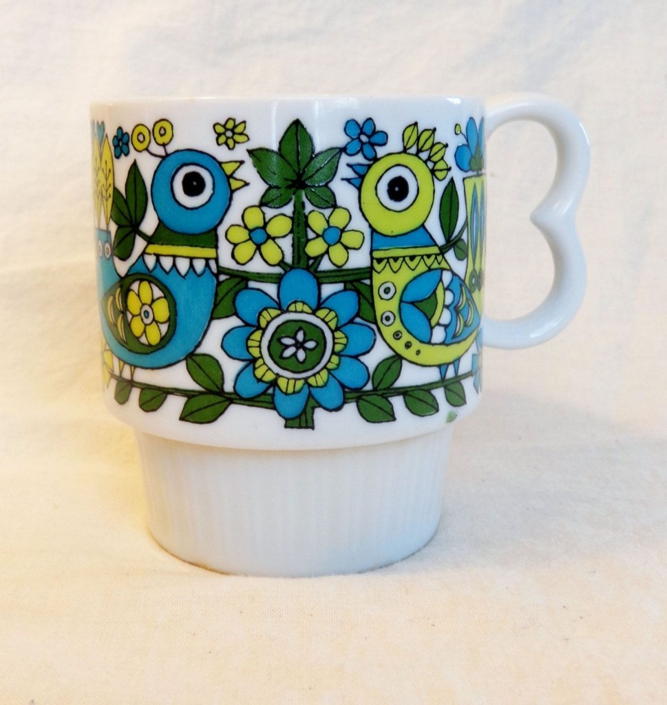 retro floral print coffee cup 1960s or 70s mug with blue