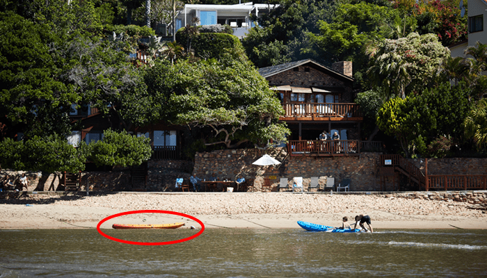 Image of kayaks in the water at Under Milkwood in Knysna