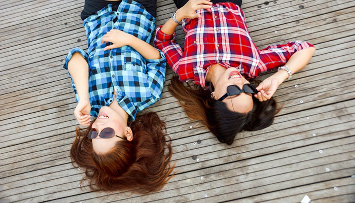 Image of girls lying on the deck laughing
