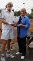 Barbara Wancke hands Murray Sutton the trophy after defeating rivals Telford Park