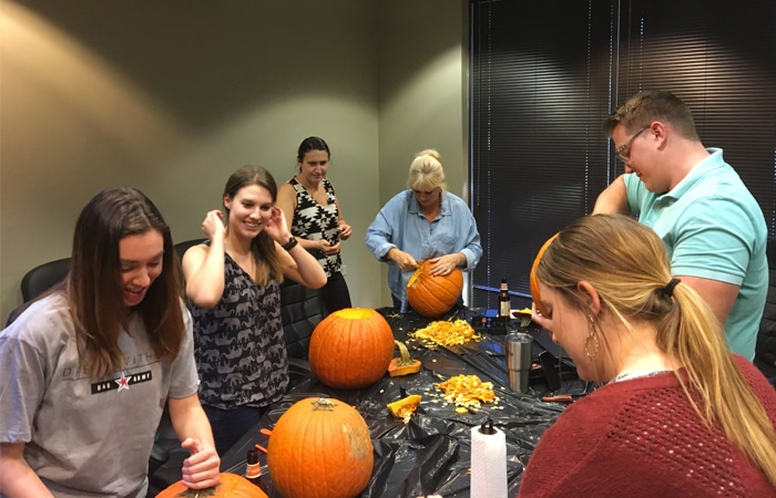 Pumpkin carving on Halloween at Miler Ad Agency